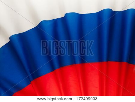 Pleated Russian Federation national flag as a background