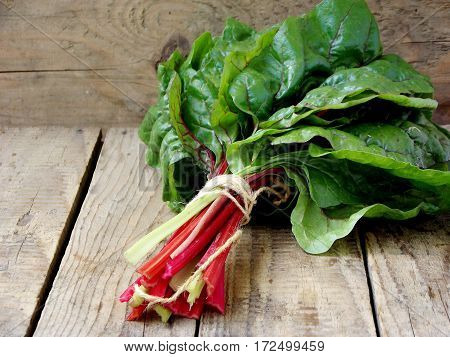 Freshly Picked Green And Red Colored Swiss Chard On Wooden Background