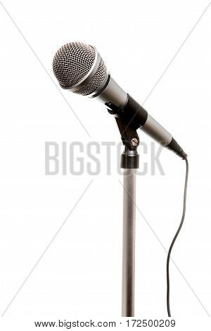 Chrome microphone seen from an angle isolated on a white background