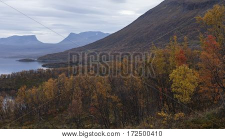 Nordic mountains in overcast weather, autumn fall. Well known landmark in northern Sweden along the road Narvik - Kiruna.