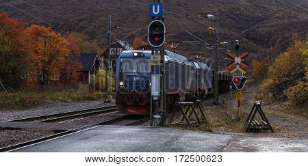 BJORKLIDEN, SWEDEN ON SEPTEMBER 20. An Iron Ore train pass the station on September 20, 2016 in Bjorkliden, Sweden. The train slow down around the station. Editorial use.