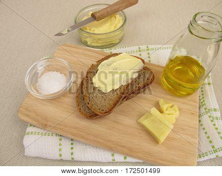 Homemade vegan margarine on bread on wooden board