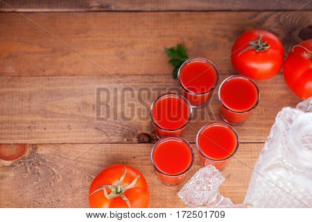 Glasses of fresh tomato juice and tomatoes