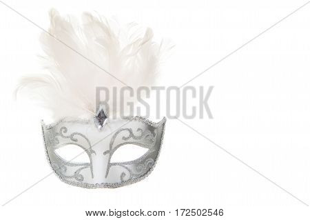 Pretty venetian silver and white carnival mask with feathers isolated on a white background