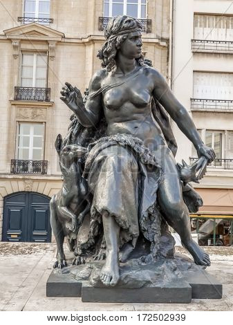 PARIS, FRANCE - 25 AUGUST, 2013 - One of six statues representing six continents - Oceania, outside of d'Orsay Museum, Paris, France