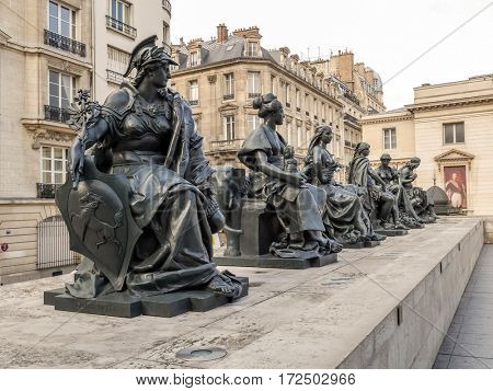 PARIS, FRANCE - 25 AUGUST, 2013 - Statues of six women representing six continents, outside of d'Orsay Museum, Paris, France