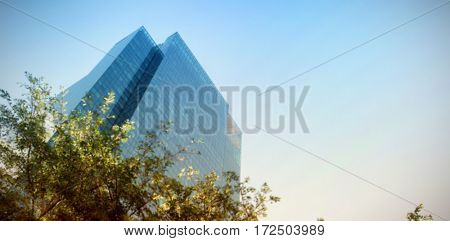 Low angle view of buildings against clear sky blur