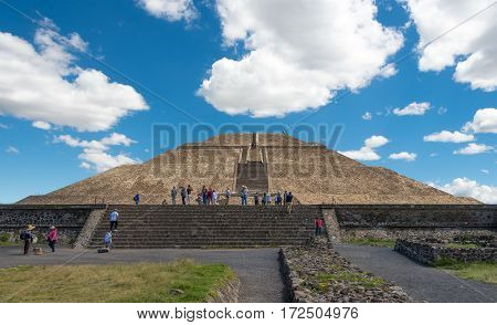 San JuanTeotihuacan Mexico - October 13 2016: Tourists standing on Plaza of the Sun getting ready to climb to the top of the Pyramid of the Sun in San JuanTeotihuacan near Mexico City in Mexico.