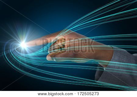 Businessman hand pointing finger against black background with shiny blue lines