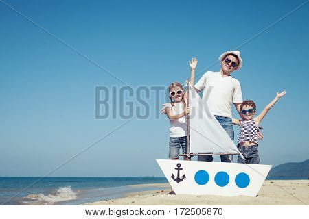 Father And Children Playing On The Beach At The Day Time.