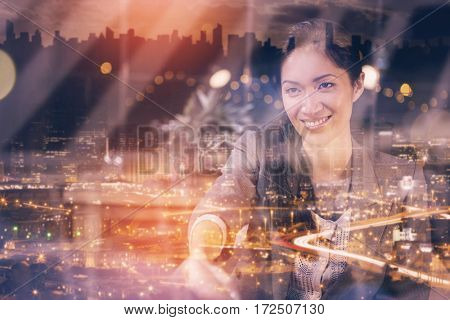 High angle view of illuminated cityscape against businesswoman shaking hands with colleague