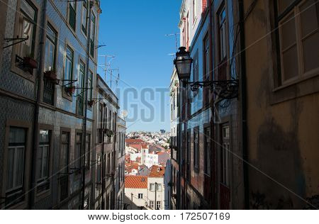 Street in Portugal. Narrow street of Lisbon, old district with historical buildings