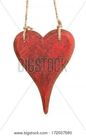 Red wooden heard shape hanging on rope isolated on a white background