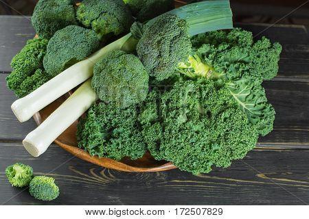 Green winter fresh organic superfood - Kale green cabbage broccoli and leeks prei