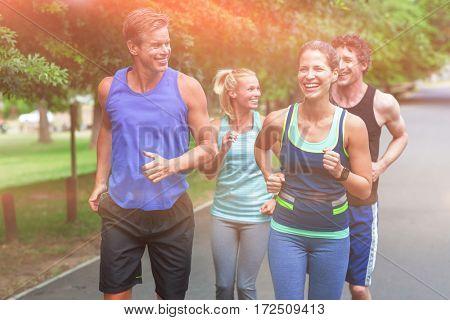 Marathon athletes running in park