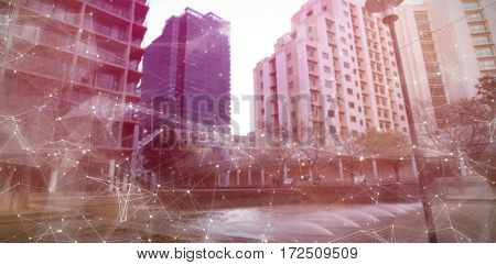Constellation between stars against buildings against sky on sunny day
