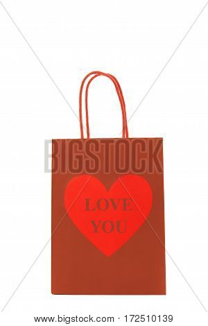 Red gift bag with a heart and I love you text on it isolated on a white background
