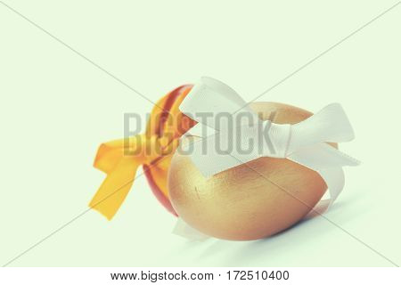 Golden egg on white background