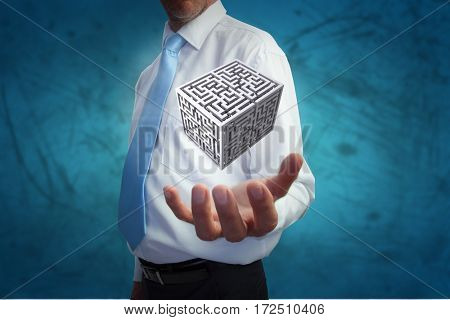 Businessman holding hand out against blue vignette background
