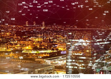 Screen with times against high angle view of illuminated crowded cityscape