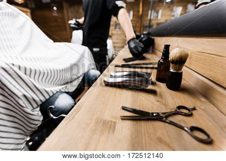 Professional haircut and shaving set on workplace of hairdresser