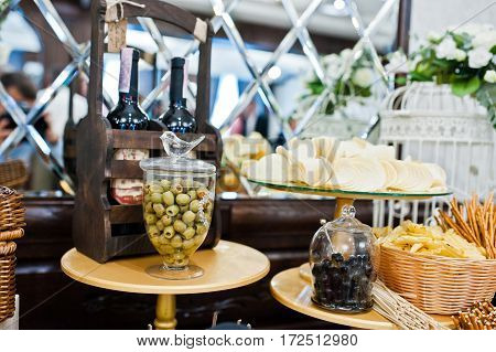 Different Olives, Chips And Salted Sticks On Wedding Reception.