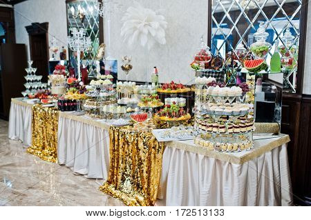 Table Of Different Sweets, Cakes And Fruits On Wedding Reception.
