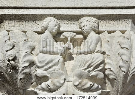 Medieval relief of venetian marriage with wedding presents on Doge Palace ancient capital in Venice