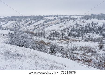 Winter landscape with soil erosion in Ukraine