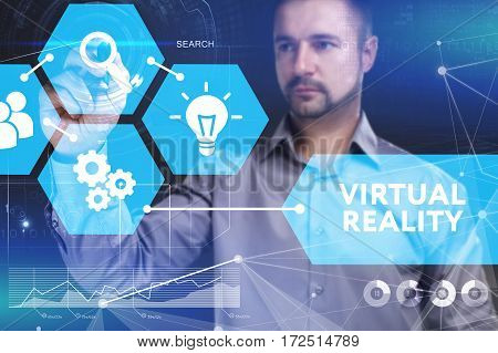Business, Technology, Internet And Network Concept. Young Businessman Shows The Word On The Virtual