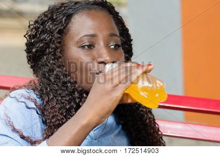 young woman often mitigated her thirst with drink.
