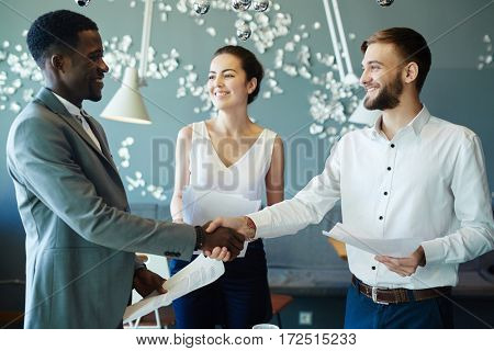 New partners handshaking after negotiation