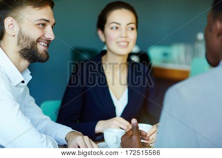 Businessman listening to co-worker at meeting