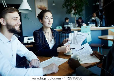 Confident lawyers consulting businessman about terms of contract