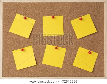 lot a yellow stickry note on wooden frame cork board.