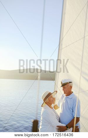 Amorous seniors dancing on yacht