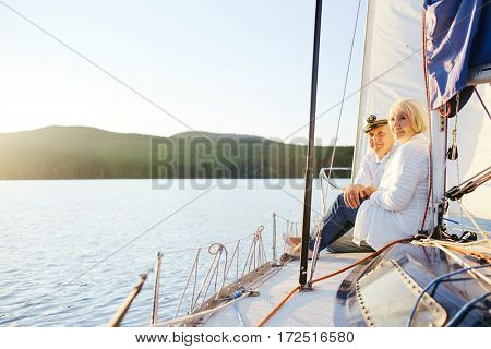 Relaxed senior couple enjoying morning on yacht
