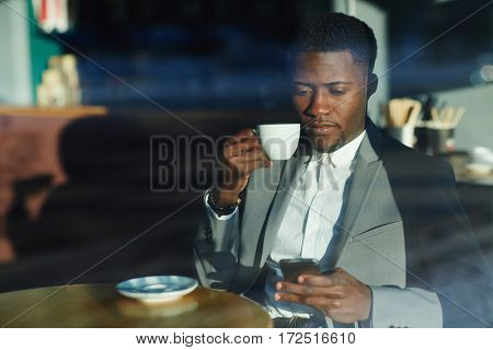 Modern banker sitting in cafe in the morning