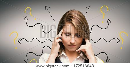 Businesswoman with headache against grey vignette