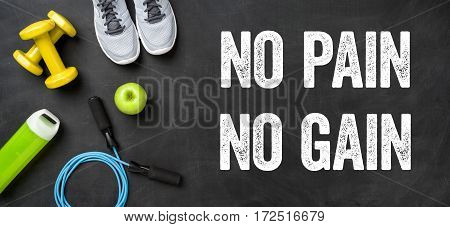 Fitness Equipment On A Dark Background - No Pain No Gain