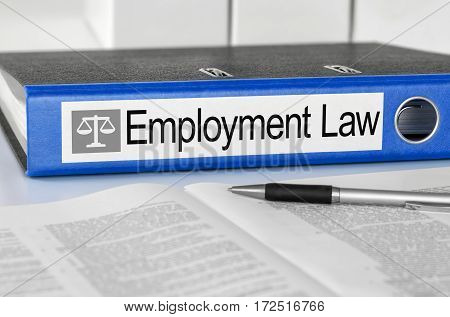 Blue Folder With The Label Emplyment Law