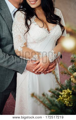 Lovers Bride And Groom In Christmas Decoration .