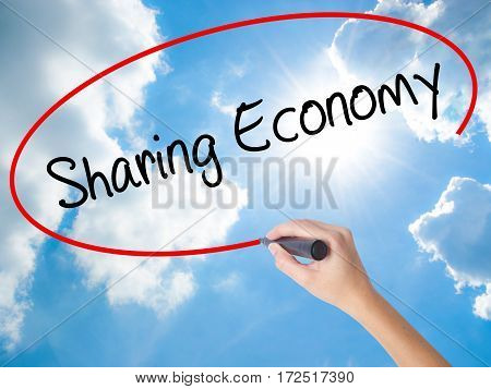 Woman Hand Writing Sharing Economy With Black Marker On Visual Screen