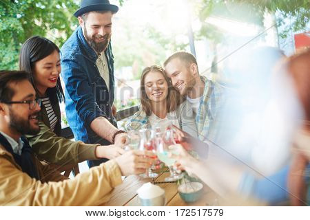 Affectionate couple and friends enjoying get-together