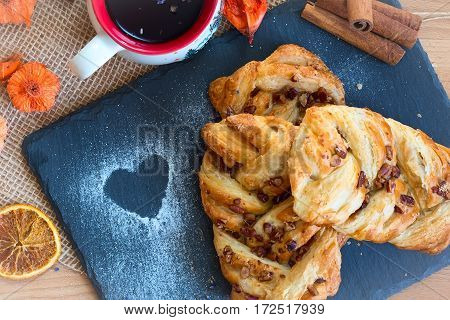 marple and pecan plait pastry sweet food breakfast with heart sign and tea cup