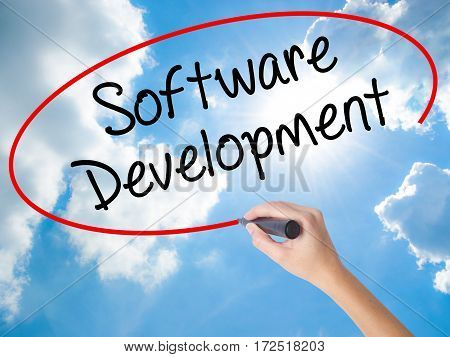 Woman Hand Writing Software Development With Black Marker On Visual Screen