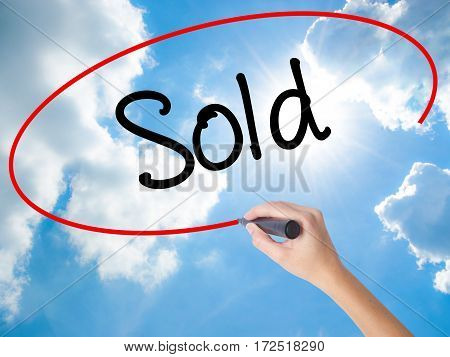 Woman Hand Writing Sold With Black Marker On Visual Screen