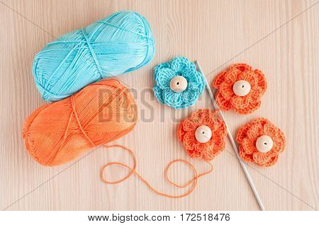 Handmade knitted crochet flowers and wood beads. Top view