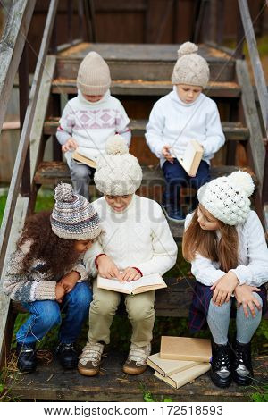 Little readers looking through their favorite books