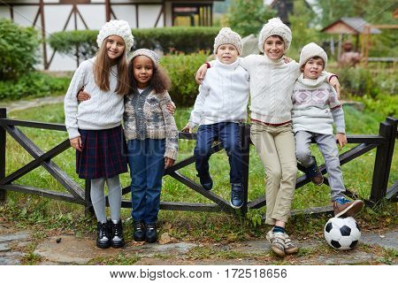 Friendly boys and girls in stylish casualwear looking at camera